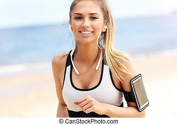 Woman jogging on the beach - Picture of woman jogging on the...