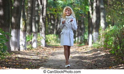 Young woman walking in park -  Two versions sequentially.