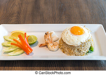 Seafood fried rice with squid and shrimp top with fried egg