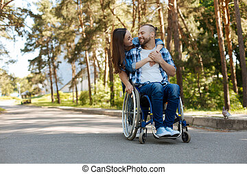 Smiling woman embracing her boyfriend - Emotional moment....