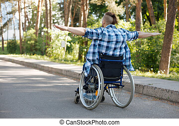 Happy male person feeling alive - Be positive. Disabled man...