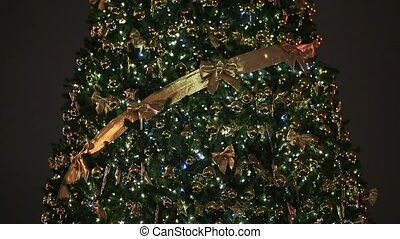 A magnificent Christmas tree, with flickering lights and...