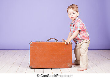 little boy going on a journey with suitcase - little boy...