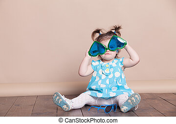 little girl plays with big glasses, she funny - little girl...