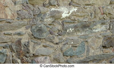 Old stone wall with an irregular pattern