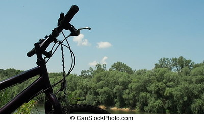 Mountain bike in the background of nature. Bicycle close-up.
