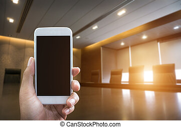 Man's hand shows mobile smartphone in vertical position and...