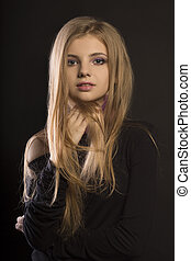 Lovely young woman with perfect makeup posing at studio -...