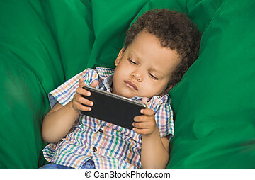 Little Boy Using Digital Device Modern Technology - Little...