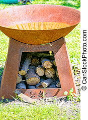 Fire bowl made of iron with wood under this - A Fire bowl...