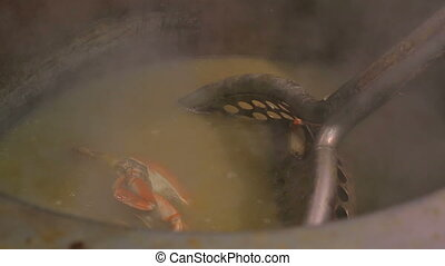 Crab boiling in a big pan. Crabs cooking in a big cauldron....