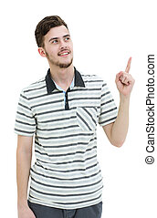 Young man pointing at something with his finger isolated on...
