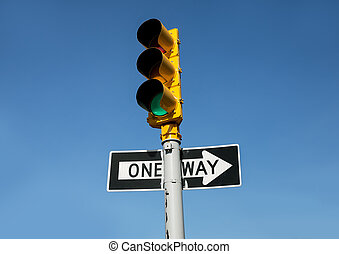 Traffic light and One Way road sign