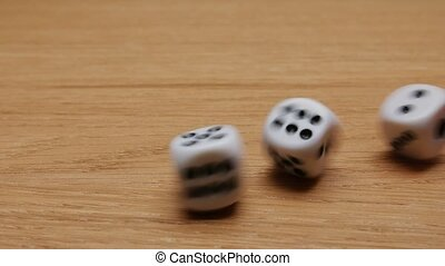 Dice rolling on the table. Close-up.