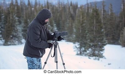 Photographer in winer mountain