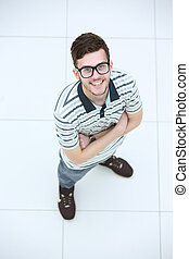 View from above of a young smiling man wearing glasses - Top...
