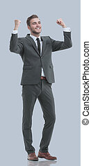 Excited smile business man raised arms, isolated over gray...