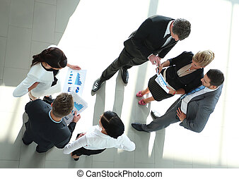 Successful busines team discussing in a modern office -...