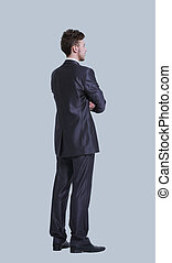 Young  business man full body side view isolated on gray backgro