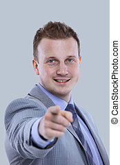 Smiling business man in a suit pointing with his finger -...