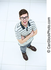 Top view of cheerful young man in casuel wear keeping arms...