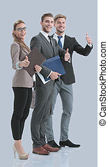 Happy business people in formalwear showing thumbs up.