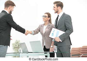 Close up of business handshake in the office - Business...