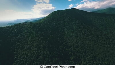 shooting mountains aerial view,wooded hills,shot from a...
