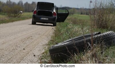 Used tire eliminated at roadside. Nature pollution. - Used...