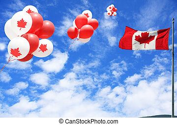 Canada day - Canadian maple leaf flag and balloons in the...