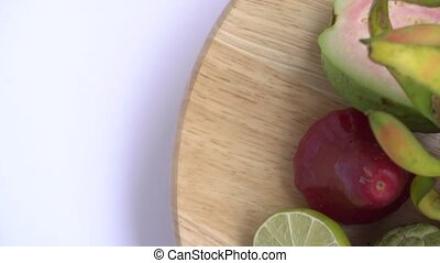 Fruit spin on wooden background. Close up footage of exotic...