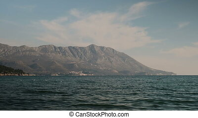 The mountains, rocky beach and sea is landscape in a cool...