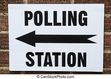 Polling Station Sign - A sign pointing in the direction of a...