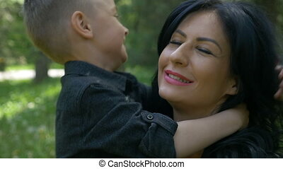 Young attractive mother and son hugging feeling happy and...