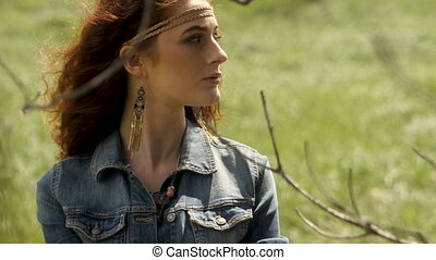 Pretty young woman looking away on field - Horizontal...