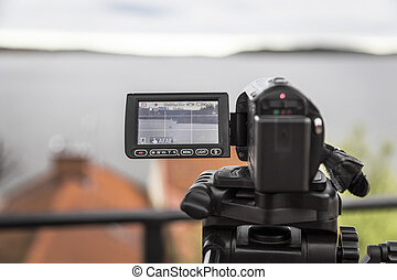 video camera shoots a landscape with a yacht - A video...