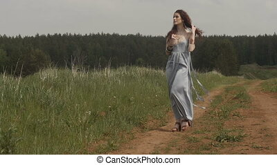 Woman walking on road in countryside