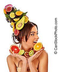 Hair mask from fresh fruits on woman head. Bare shoulders -...