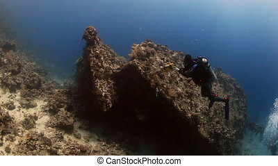 Cameraman diver swimming deep underwater in Red sea. - Egypt...