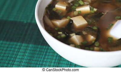 Panning shot of big bowl of miso soup - Extreme close up of...