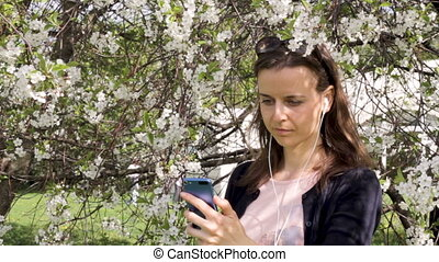 Young girl checking her mobile outdoors