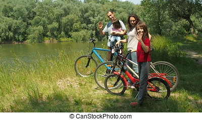 Family in nature with bicycles.