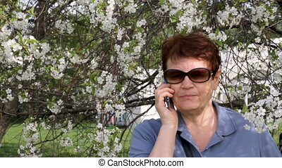 Senior woman having conversation on smartphone