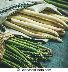 Fresh green and white asparagus in towel, square crop -...