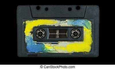 Old color audio tape in a player