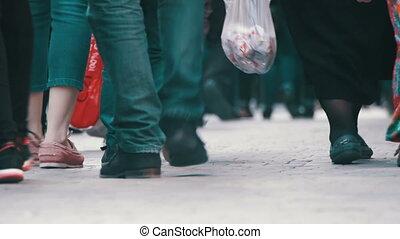 Crowd of People Walking on the Street. Crowd Feet.