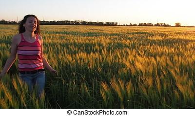 Woman in a field of wheat.