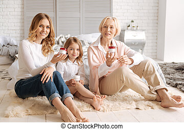 Beautiful women of different age holding creams - Love for...