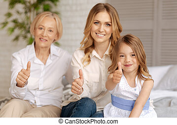 Three women of different age showing thumbs up - Love being...