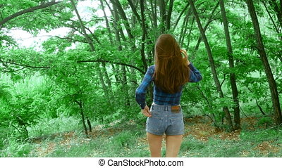 young adorable woman in jeans shorts with beautiful buttocks...